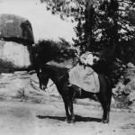 Mary Thomas on horseback by Hemet Lake